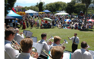 Gloriavale's brass band performing at the park in Greymouth