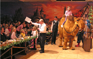 Offering members of the audience a camel ride at a concert